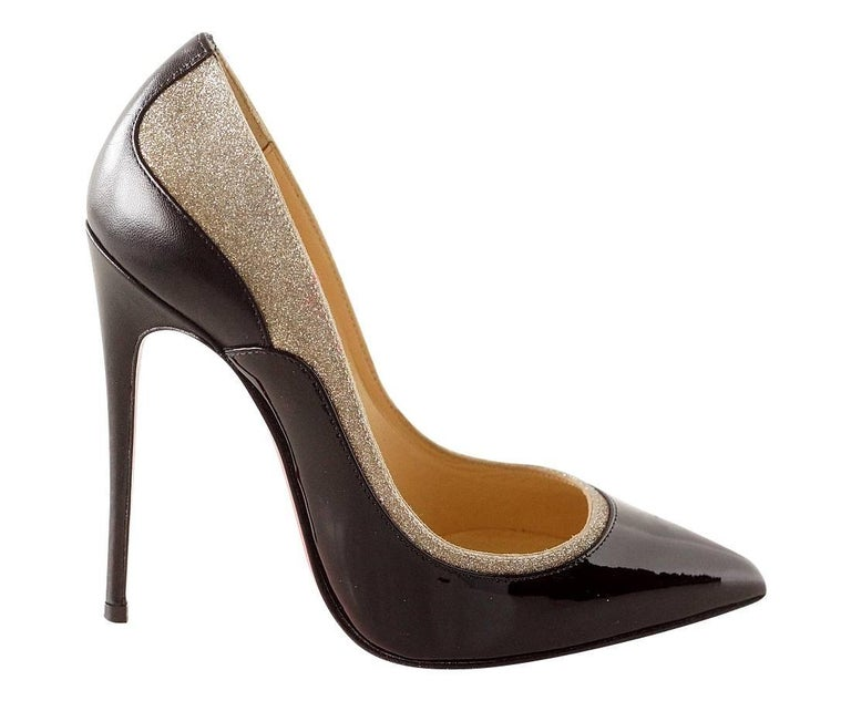 Guaranteed authentic signature Christian Louboutin 'Pigalle' pump in a rare small size. Pigalle Stiletto heel black patent leather pump accentuated with calf leather and silver glitter. The back of the shoe is black leather with patent leather front