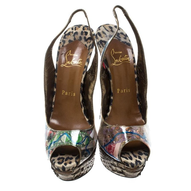 These sandals from Louboutin are a note on eco-friendly fashion. They are crafted from trash-printed PVC and designed with peep toes, slingbacks and leopard-printed heels supported by snakeskin platforms.  Includes: The Luxury Closet Packaging