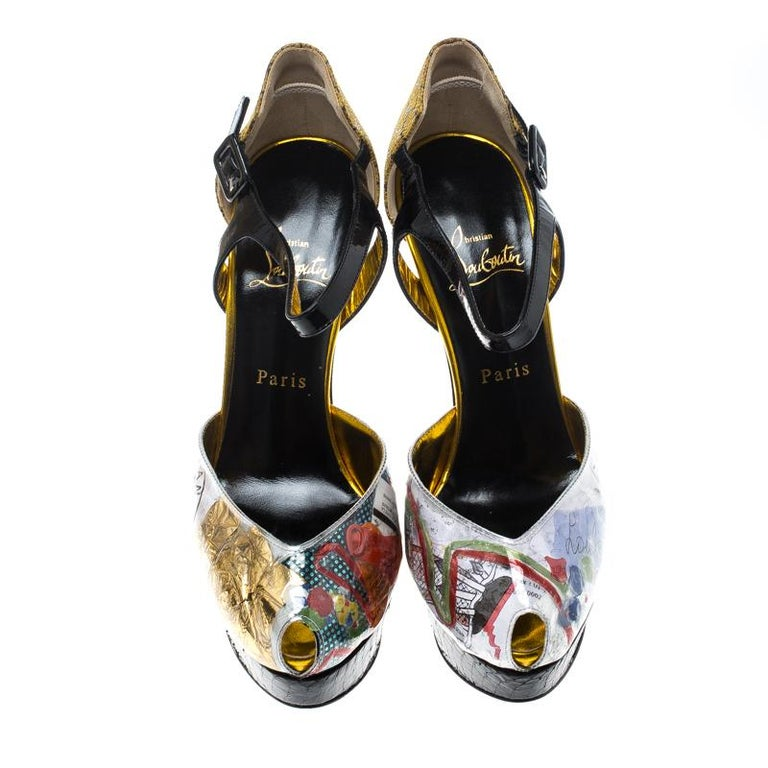 These pumps from Louboutin are a note on eco-friendly fashion. They are designed with prints of trash on PVC, snake-printed embossed suede on the counters and heels, ankle straps, and snakeskin platforms.  Includes: Original Dustbag, Price Tag,