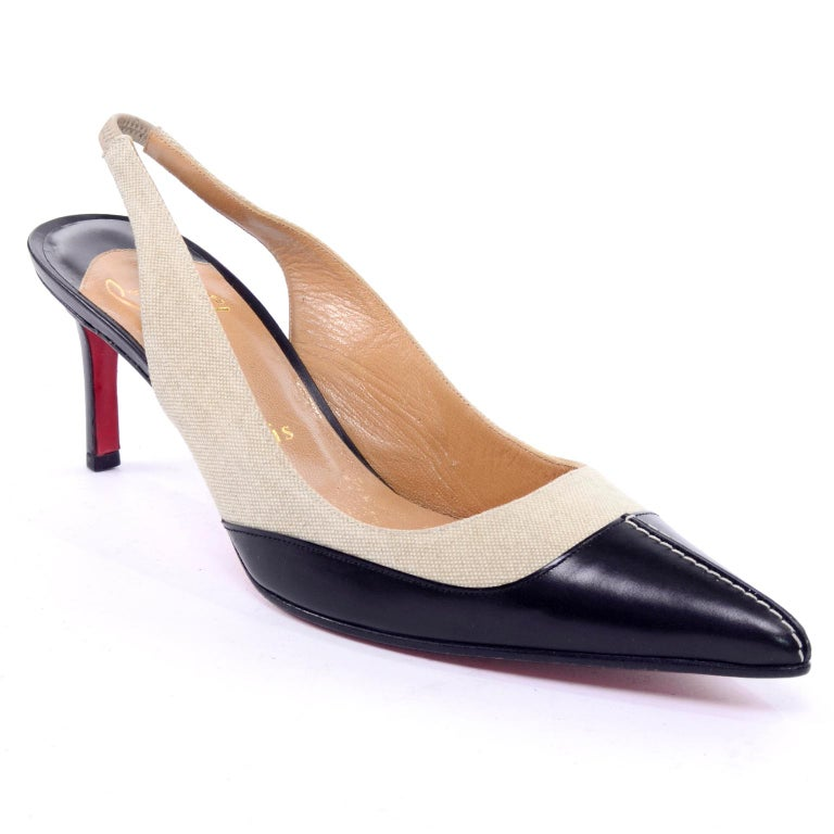 These are classic sling back shoes from Christian Louboutin with black  leather and natural canvas.