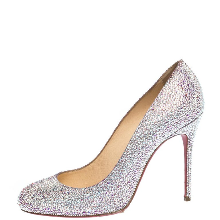 Every shoe collection needs a pair of classic pumps like these Christian Louboutin beauties. They have been crafted from silver-hued stress and styled with round toes, signature red soles and 11 cm heels. Add this pair to your closet today and