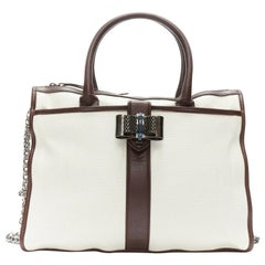 CHRISTIAN LOUBOUTIN Sweet Charity beige canvas silver metal bow chain tote bag