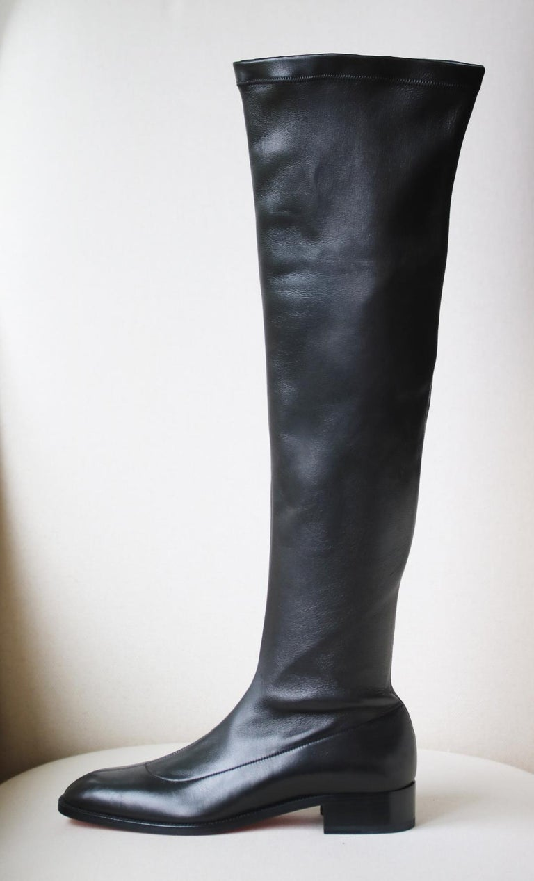 Christian Louboutin's 'Theophila' over-the-knee boots are inspired by the minimalistic design of riding boots.  They've been made in Italy from naturally stretchy black leather that forms to your legs without slouching.  The stacked heel adds just