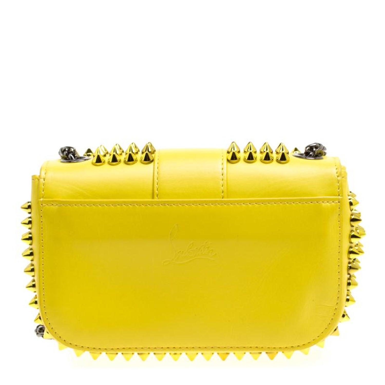 9a9f55cf368 Christian Louboutin Yellow Leather Mini Spiked Sweet Charity Crossbody Bag