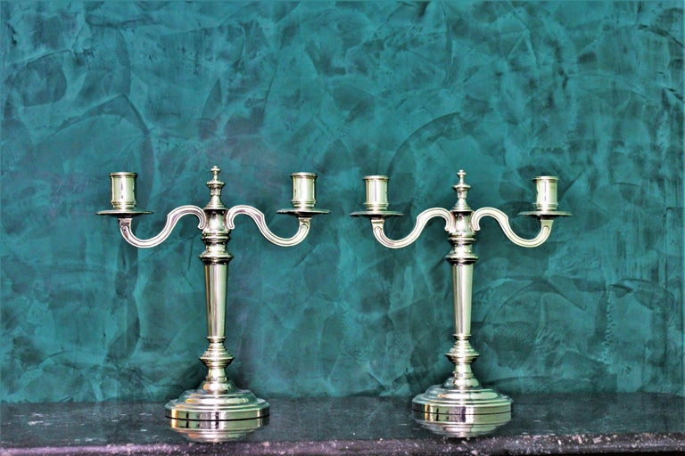 Pair of Christofle candlesticks, realized by the French Maison located in Paris with the typical Christofle alloy. Beautiful, elegant and in very good condition. Dimensions: Height 26.5 cm, width 25.5 cm, depth 10.5 cm, weight 2638 gr.