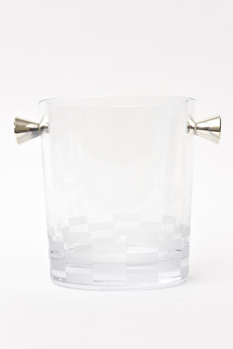 This lovely hallmarked French Christofle ice bucket/ champagne bucket/ barware is signed. It has at the bottom 2 rows of checker board etched frosted glass and two sculptural silver plate handles on either side. It is Classic and timeless. This is