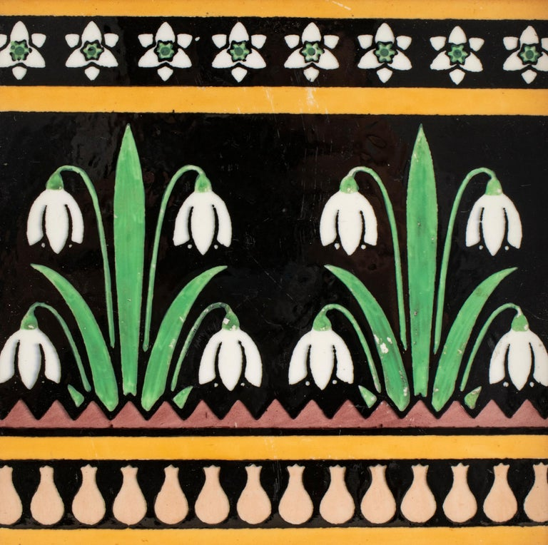 English Arts & Crafts Minton pottery tile designed by Christopher Dresser, late 19th century, featuring Art Nouveau / Aesthetic Movement lily of the valley floral motif, the tile reverse with embossed stamped letter