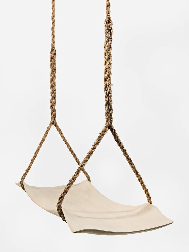 Hand-carved Alaskan cedar wood swing by Upstate New York-based artist and designer Christopher Kurtz. Can be installed outside or inside. Available in custom sizes and woods.