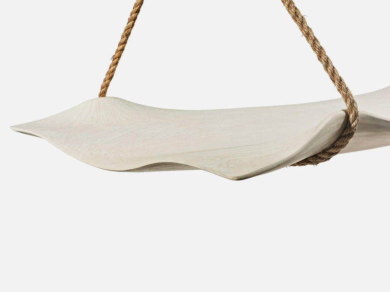 Hand-carved basswood and milk paint swing by Upstate New York-based artist and designer Christopher Kurtz. One available now and additional custom works available on commission.