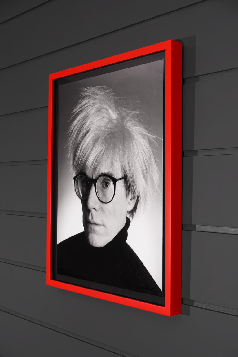 The 'Andy Portrait' is an archival pigment printed photograph on 3mm dibond, featuring the beloved pop-art icon Andy Warhol, by Christopher Makos. This exclusive print is an edition of only ten in existence, each signed and numbered by the artist on