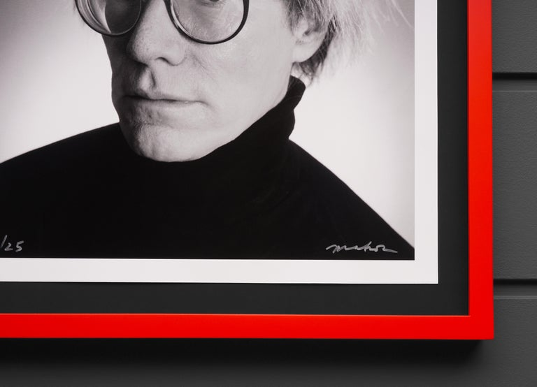 The 'Warhol Print' is an archival pigment print on paper, an exclusive photograph of the beloved pop-art icon Andy Warhol, by Christopher Makos. This exclusive print is an edition of only twenty-five in existence, each is signed and numbered by the