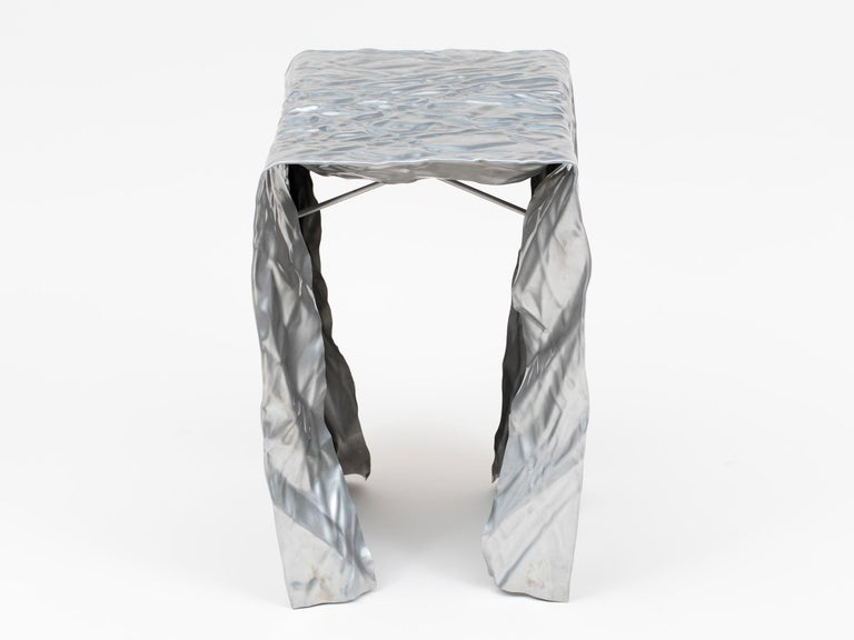 Wrinkled brushed stainless steel stool by Omaha-based designer Cristopher Prinz. Can be used indoors our outside.