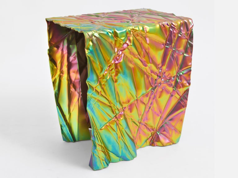 Wrinkled stool or side table by Omaha-based designer Cristopher Prinz, who achieves this unusual texture by repeatedly creasing a thin sheet of steel, resulting in a strong, rigid, and unique form. Adapted from an automotive use, the electroplated