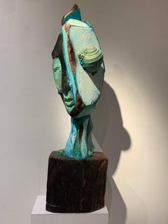 Listening, wood, acrylic, mixed media sculpture, green, blue, off white, brown