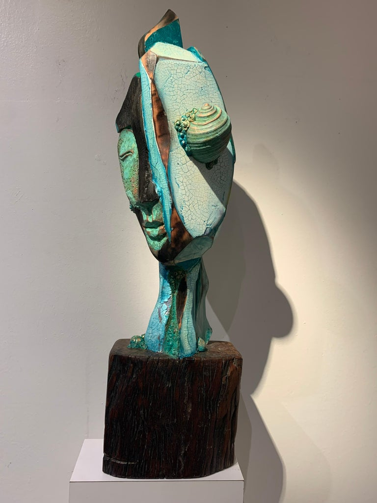 Chris Reilly Figurative Sculpture - Listening, wood, acrylic, mixed media sculpture, green, blue, off white, brown