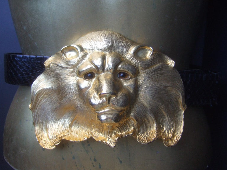 Christopher Ross Massive 24k gold plated gilt metal lion buckle belt c 1984 The incredible huge scale designer belt is adorned with a dramatic show-stopping gold plated lion head buckle  The ornate lion head buckle is paired with a sleek black