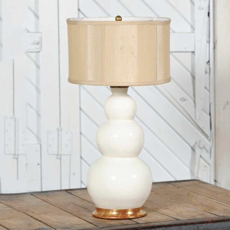 Handsome iconic ceramic lamp by Christopher Spitzmiller in his white blanc de chine color and glaze and the large size three ball design with the Spitzmiller label. It is in fabulous vintage condition with no flaws we have discovered. It does not