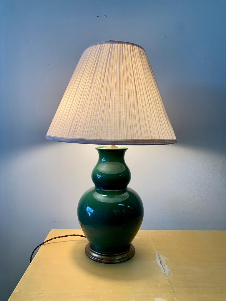 This double gourd shape in a beautiful jade green tone, this porcelain lamp with double sockets and new silk wiring. Shade is original with heavy spots from age - included if you want it.
