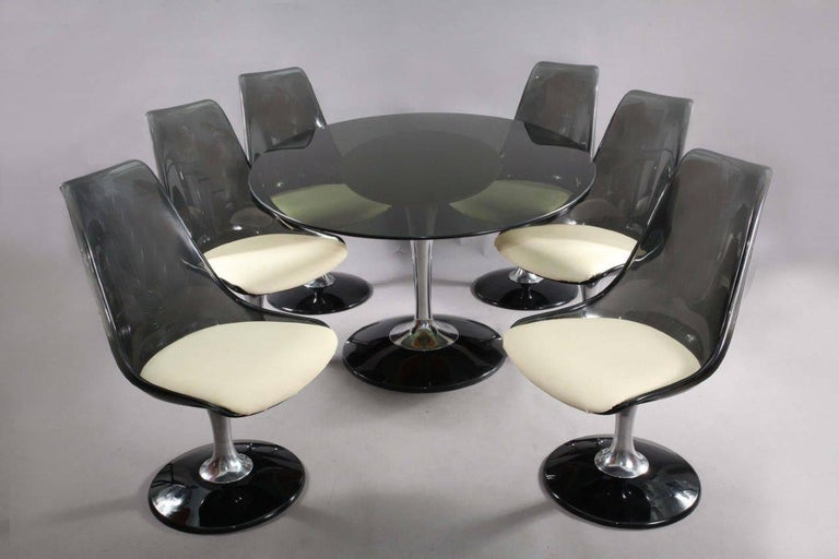 Dining room set oval table with six swiveling tulip chairs, Chromcraft 1970. chrombase, oval tulip table with smoke glass top. table: widht 150cm, depht 115, height 75cm