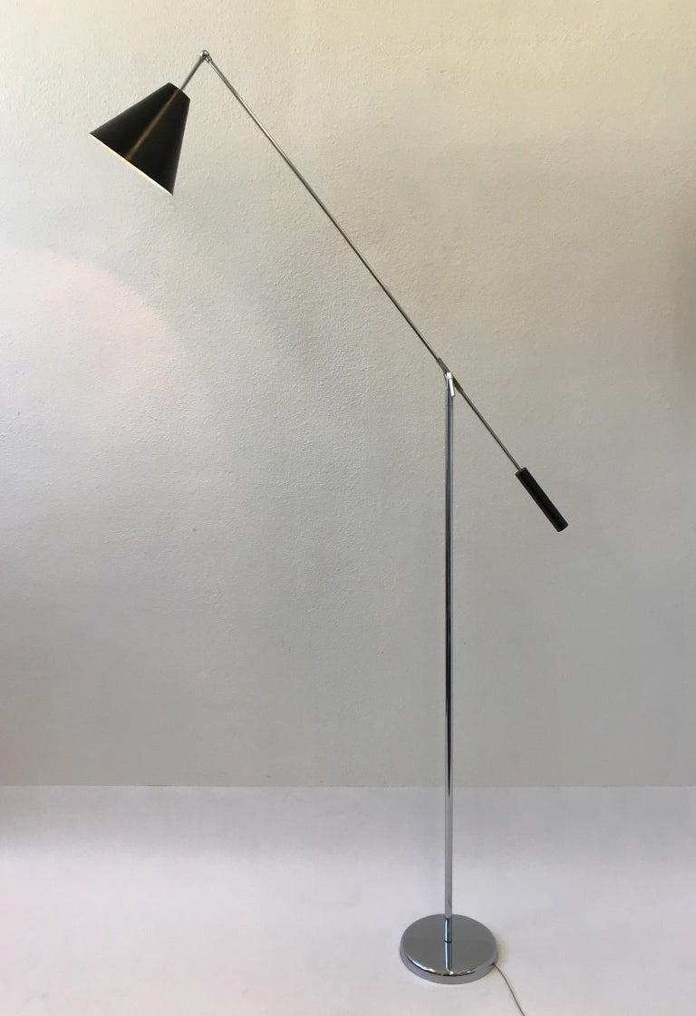 Polished Chrome and Black Lacquered Adjustable Floor Lamp by Robert Sonneman For Sale