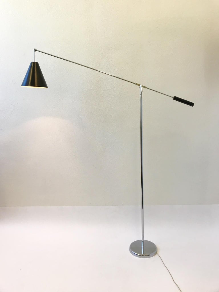 Mid-20th Century Chrome and Black Lacquered Adjustable Floor Lamp by Robert Sonneman For Sale