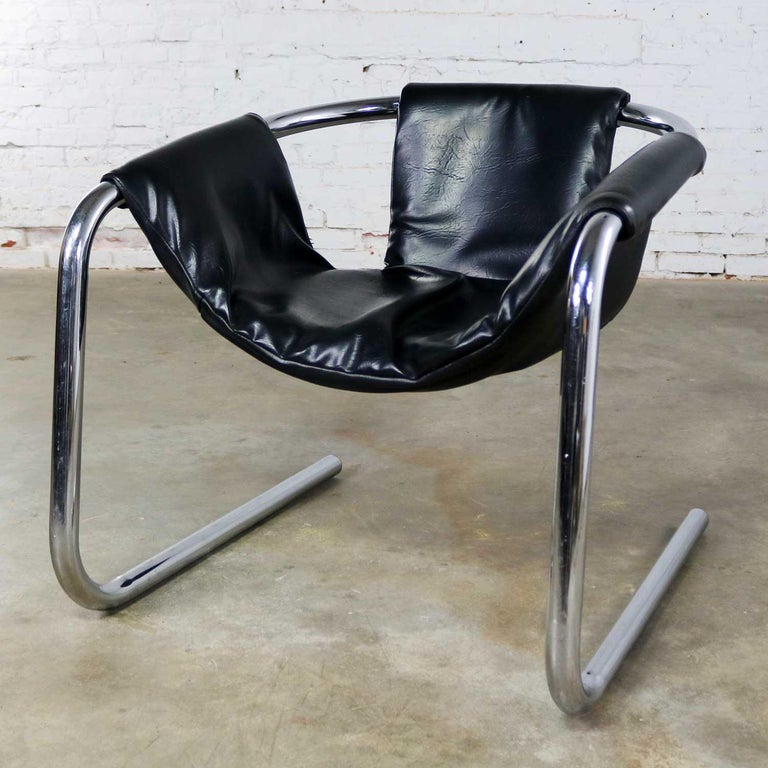 Handsome chrome and black vinyl cantilevered sling chair attributed to Vecta Group of Italy and called the Zermatt chair. This chair is in wonderful vintage condition overall. The chrome is very good but not without a small amount of age appropriate