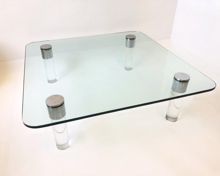 """Large 1970's lucite and chrome with 3/4"""" thick glass top cocktail table by Pace Collection. The legs have been newly professionally polished. The glass is original, has no chips, shows minor wear consistent with age. Measurements: 54"""" wide, 54"""""""