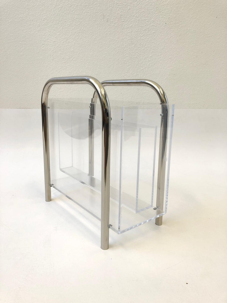 """A glamorous polish chrome and clear Lucite magazine holder design by """"Mr Lucite"""" Charles Hollis Jones in the 1970s. The Lucite shows minor wear consistent with age. Book not included. Dimensions: 8"""" deep 15.5"""" wide 15.5"""" high."""