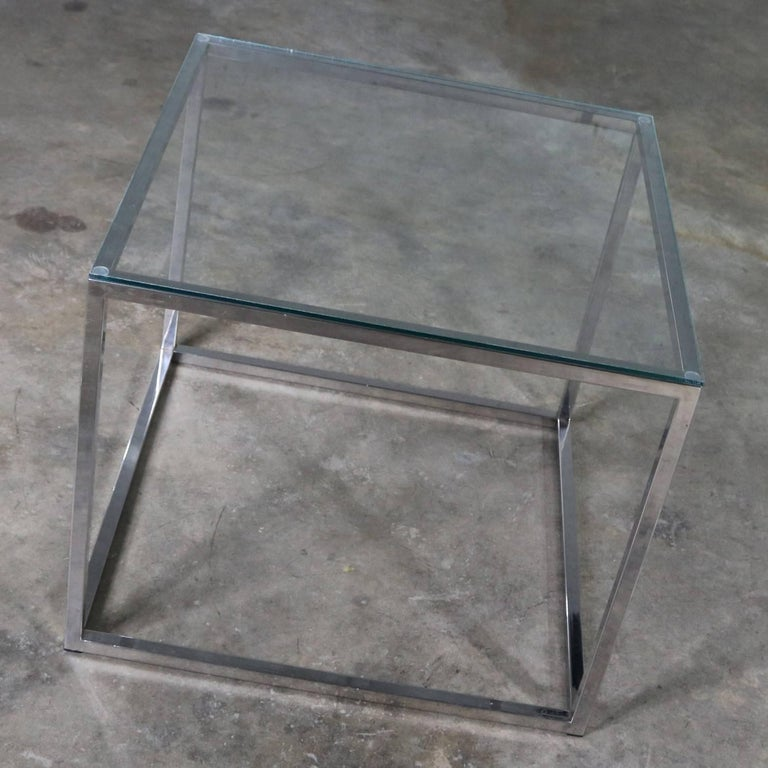 Handsome chrome cube end or side table with glass top done in the manner of Milo Baughman. This piece is in awesome vintage condition with new glass top, circa 1970s.  Simplicity at its best. This fabulous end table is done in the style of Milo