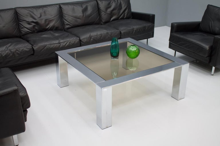 Chrome and glass coffee table, 1970s. New glass top.