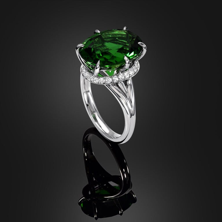 Rare, extraordinary and vibrant 7.70 carat Chrome Green Tourmaline oval, is set in this ultra fine 6 claw prong setting, and a total of 0.26 carat round brilliant diamonds, to compose this remarkable hand crafted platinum cocktail ring. This gem