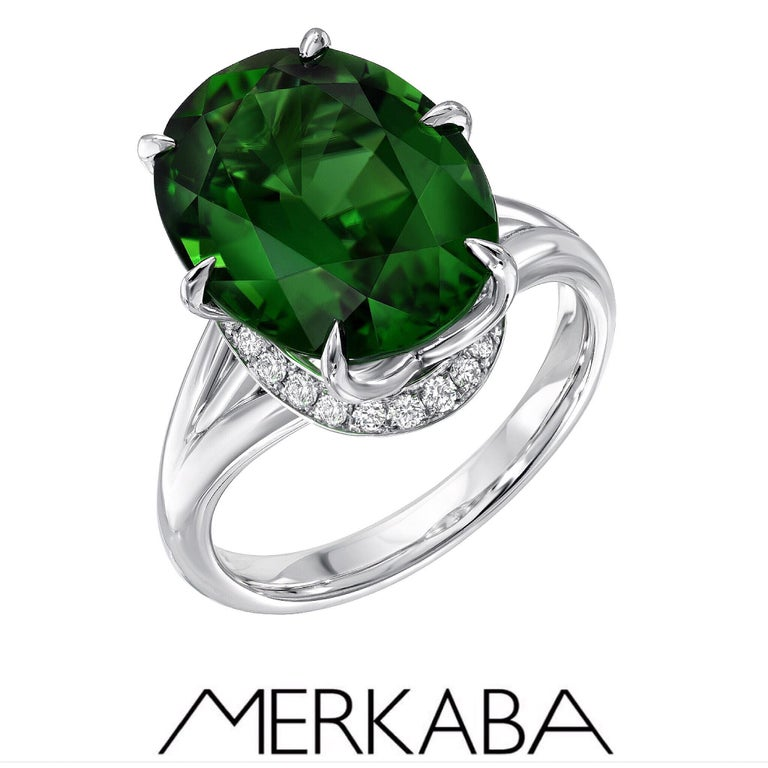 This remarkable, world-class set, is also offered individually on our Merkaba storefront. Ring: Rare, extraordinary and vibrant 7.70 carat Chrome Green Tourmaline oval, is set in this ultra fine 6 claw prong setting, and a total of 0.26 carat round