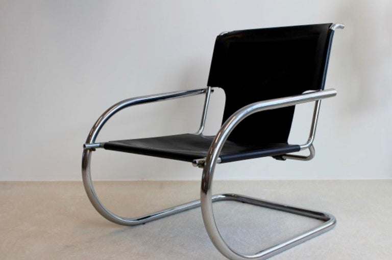 Unique and comfortable cantilever chair made by Arrben Italy. This company was specialized in making handmade leather furniture with high ergonomic quality. Leather is in very good quality with perfect patina. Chrome is in perfect condition. We have