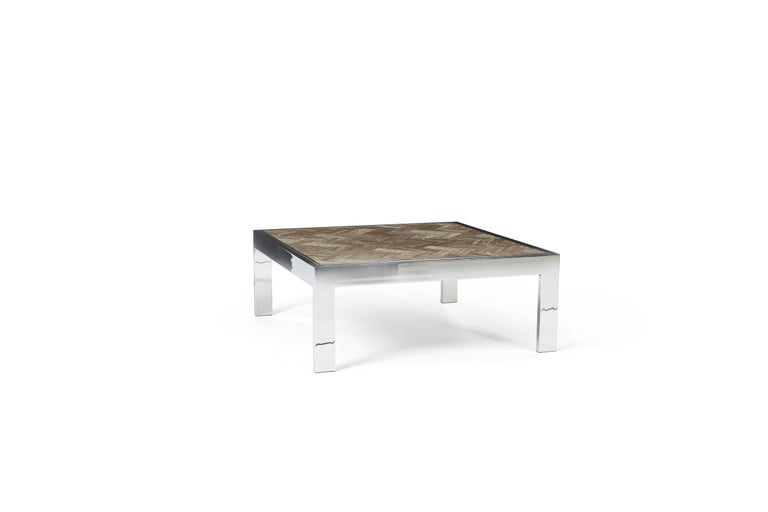 Chrome frame cocktail table with tesselated marble top. Designed by Leon Rosen for Pace.