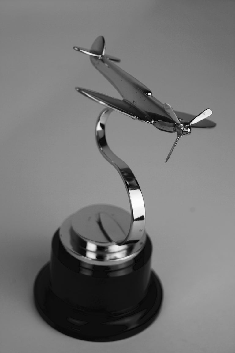 Spitfire accessory mascot. Chrome-plated, circa 1930s period depicting a Spitfire in banked position, with integral display loop mount.