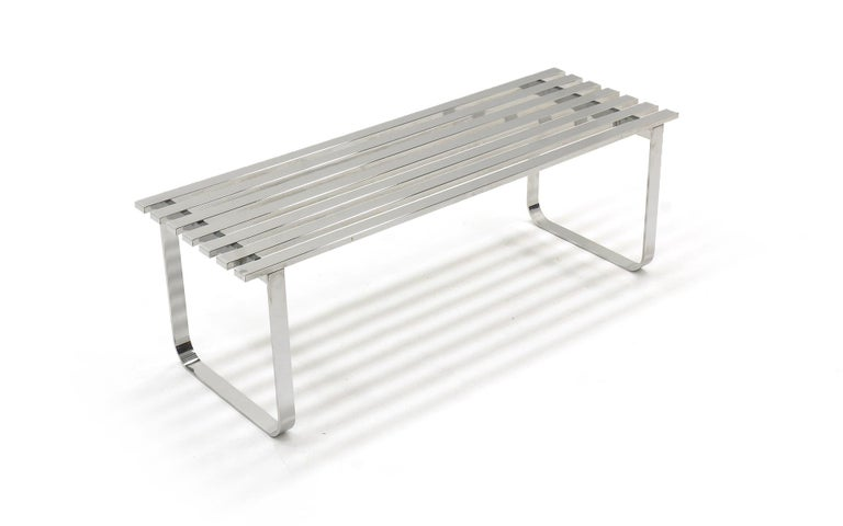 48 inch slat bench in chromed steel by Milo Baughman. Also makes an excellent coffee table. Minor surface scratches. Ready to use.