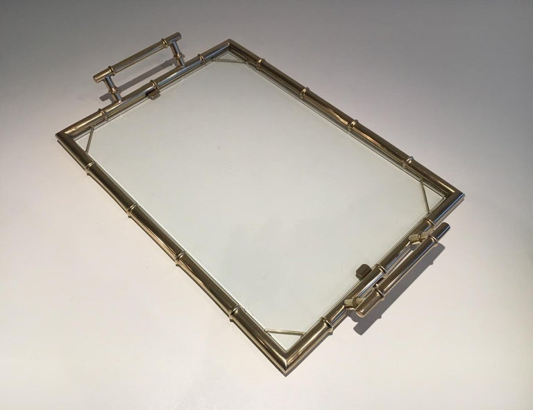This faux-bamboo style tray is made of chrome with a piece of glass. This is a French design, circa 1970.