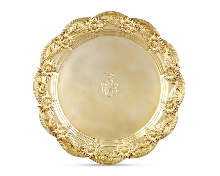 Royal provenance and luxurious gilding elevate the rarity and beauty of this service of eight Tiffany & Co. sterling silver-gilt dinner plates in the firm's beloved Chrysanthemum pattern. Commissioned for a member of European nobility, each plate