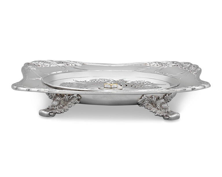 This charming sterling silver caviar server was crafted by the celebrated Tiffany & Co. in the firm's highly popular Chrysanthemum pattern. The dish is ingeniously designed to keep caviar at the perfect temperature, with a removable pierced tray at