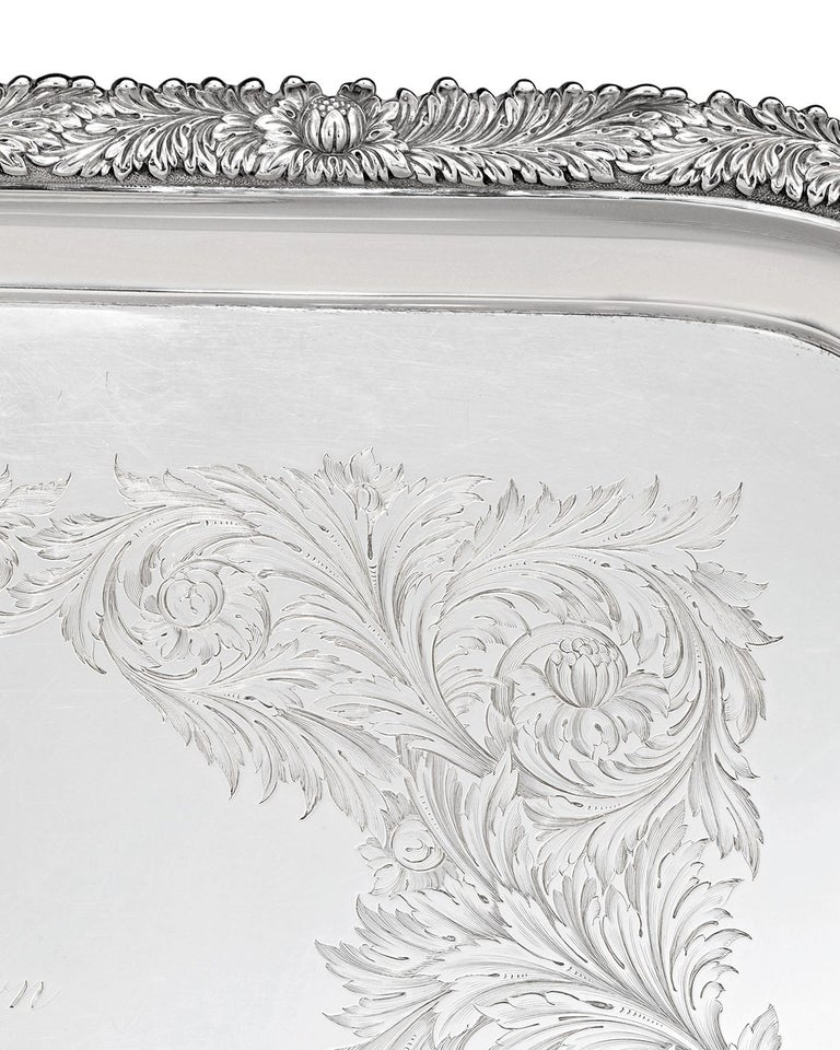 This absolutely monumental sterling silver tea tray by the famed Tiffany & Co. was crafted in the firm's famed Chrysanthemum pattern. This opulent motif's signature flowers are masterfully chased along the tray's border. Furthermore, the body of the