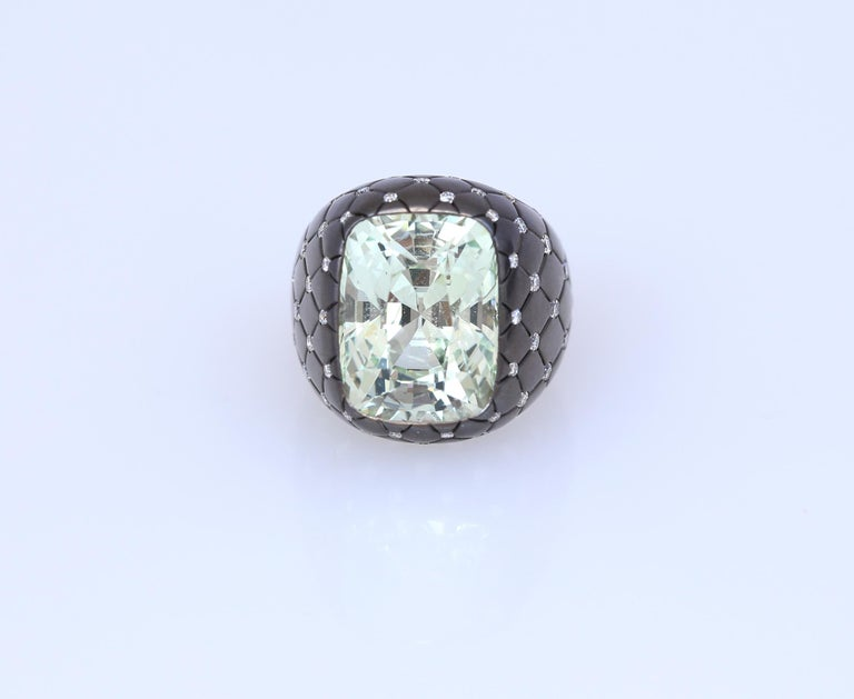 Center stone Chrysoberyl (Alexandrite) weighting 16.94Ct on a wideband engraved with lattice design accented with brilliant-cut Diamonds. Originally purchased on a Sotheby's auction London. 1990. A very unusual and interesting design, almost a