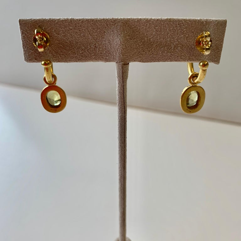 22 karat hoop earrings with fine oval Chrysoberyl drops 3.63 carats set with granulation, in the tradition of Etruscan gold jewelry. The hoops are available in 2 sizes a small 5/16 inch diameter and a larger 5/8 inch diameter. Shown here with the