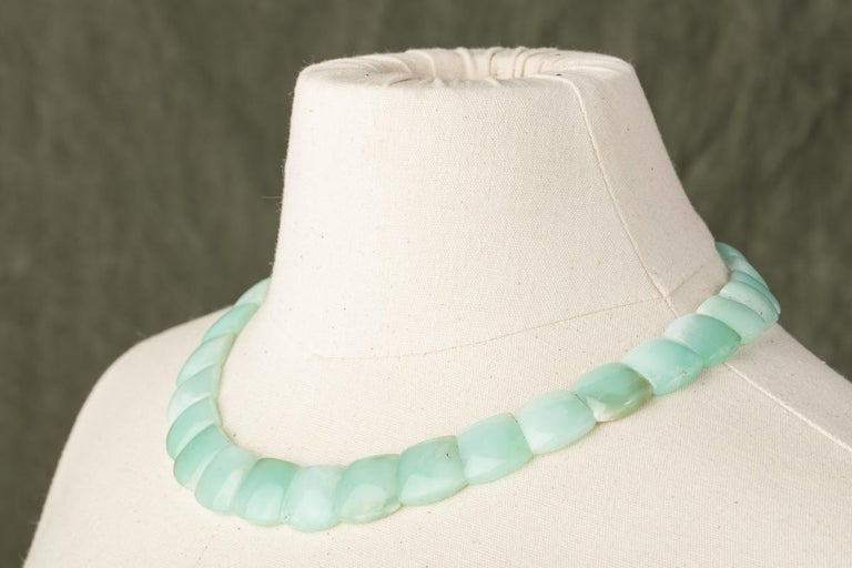 Lovely chrysophrase choker necklace, flat cut on the back side and rounded on the top.  Slightly graduated with sterling silver clasp.  468 carats.