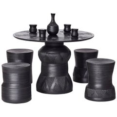 "Chuma Maweni, ""Imbizo"", Carved Ebonized Timber and Clay Stool and Table Set"
