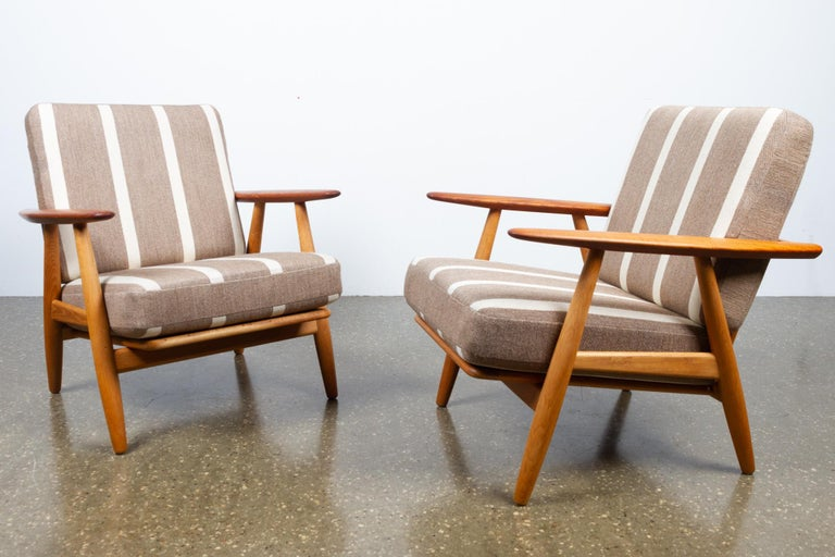 Cigar GE-240 Easy Chairs by Hans J. Wegner 1950s, Set of 2 Pair of two GE 240 armchairs in oak and teak by Hans J. Wegner for Getama Denmark. Original spring cushions with original grey and white striped wool fabric. Frame in solid oak, armrests in