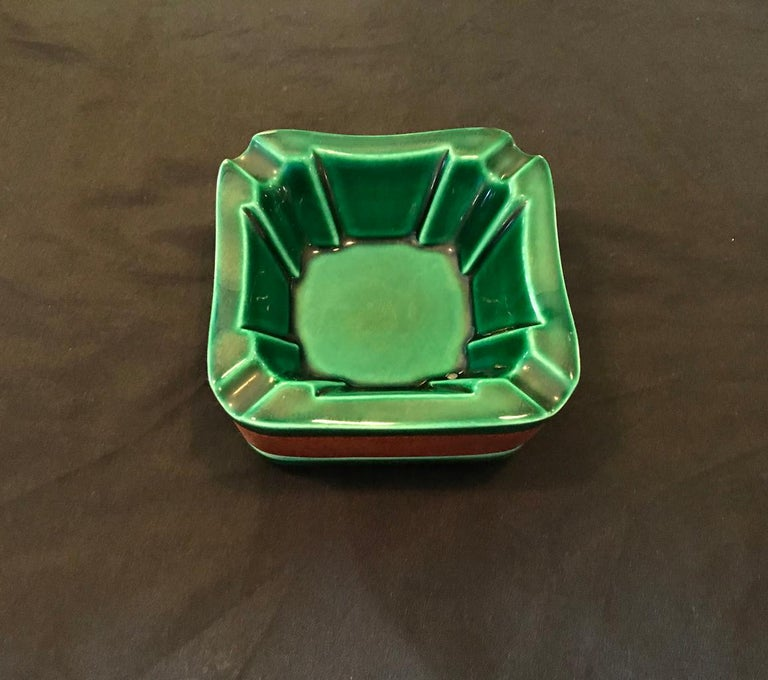 Cigar set by Longchamps in Adnet style, in green faience ceramics and brown leather composed by 1 ashtray and 1 box and its top. In a very good general condition.  Dimensions:  L 10.5cm x l 10.5 cm depth 5.5 cm ashtray L 10cm x l 10 cm depth