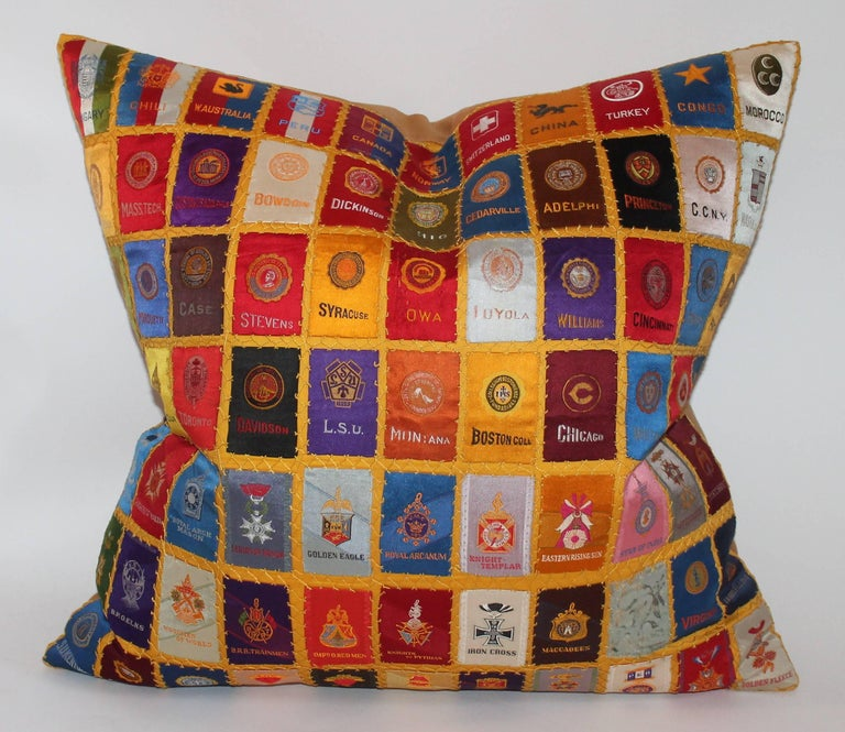 This fine example of a small quilted sham is of colleges and are cigar premiums. The condition is pristine and super rare to find.