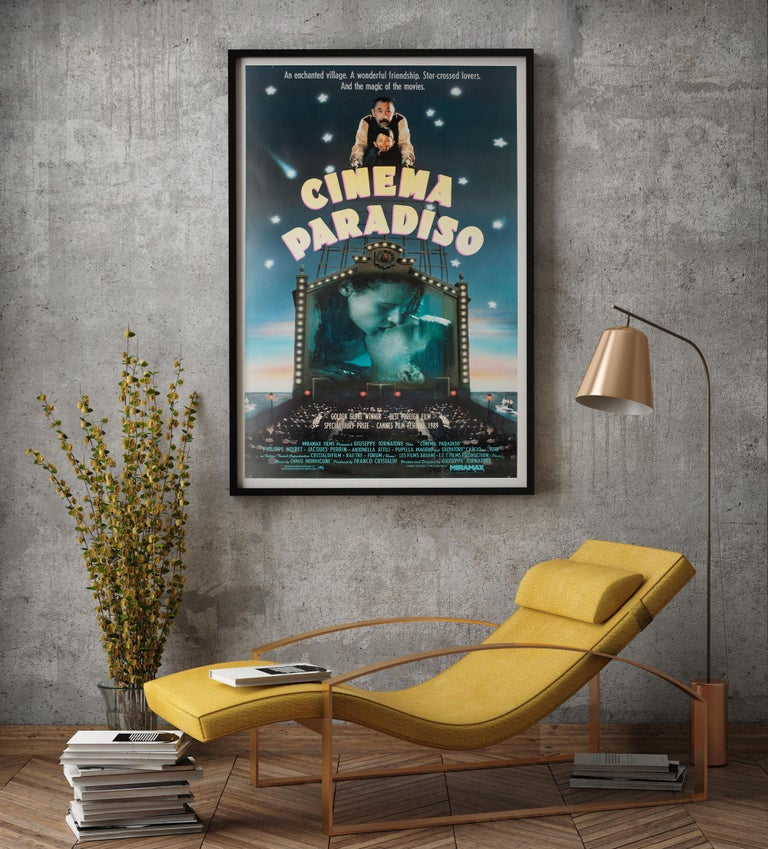 The smashing US poster for Tornatore's modern classic Cinema Paradiso.  This vintage movie poster has been professionally linen-backed in the European style (without any restoration) and is sized 27 1/2 x 40 1/2 inches (40 x 43 inches including