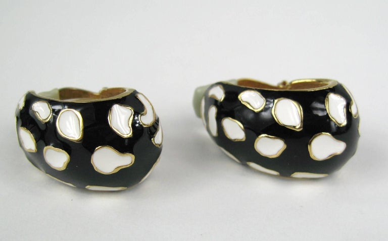 Ciner Black & White with gold tone detailing clip on earrings that measure 1.23 inches  x .78 inches wide. The matching bracelet is on our storefront as well. We have matching sets up on our storefront of many designer jewelry. This is out of a