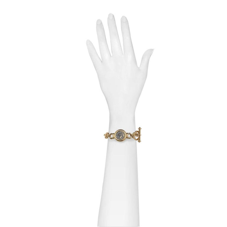 With a Roman inspired coin motif, this bracelet will be a timeless addition to your jewelry collection.  PLEASE NOTE: The pieces available are not vintage and are not reproductions. CINER uses original models to produce our jewelry today.  The Coin